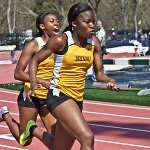 Brenau's Tia Hines passes the baton to her teammate Olamide Sokunbi during the 4x100 meter relay. The Brenau team took second in the relay.
