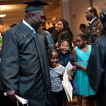 Vincentia Mensah, and Asante Collins congratulate Francis Alu-Mensah after he graduated from Brenau University Saturday.