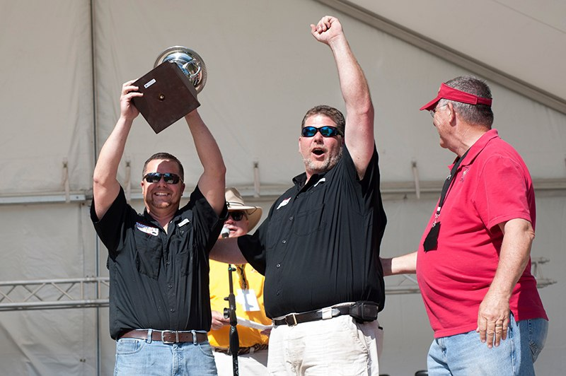 Chad Brooks, left, and Chris O'Neal cheer frmo the stage at the Brenau University Amphitheatre as the are announced the Grand Champions of the GBA competition at the Brenau Barbecue Championship. The Smokin' 42 team from Tifton, Ga. also earned first place in the GBA rib competition. By winning the Grand Championship prize, Smokin' 42 has earned a trip to Las Vegas in the fall to compete in the World Food Championships.