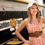 Lauren Smith poses for a picture wearing her new Brenau University hat after she signed her golf scholarship to play for Brenau University,