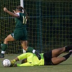 Brenau goalkeeper Tori Brown lays hands on the ball to stop Belhaven's Jordan Organ on a drive to the goal during Thursday's match. Brenau earned a 5-0 shut out.