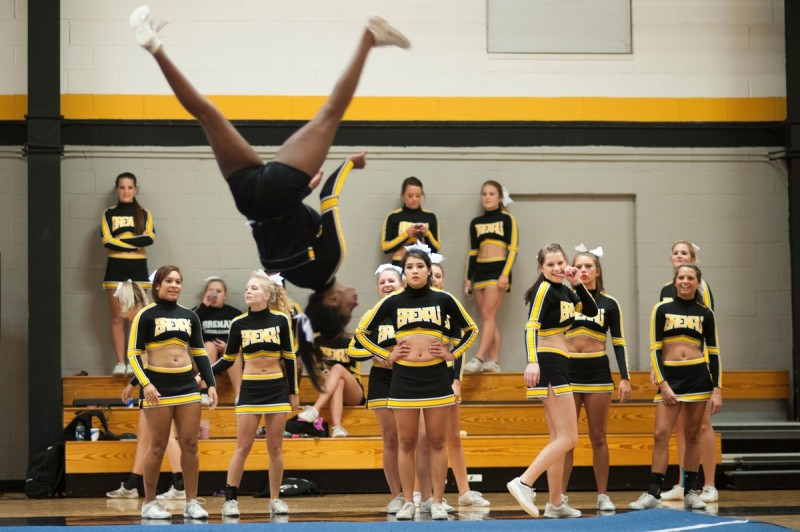 Members of the Brenau University Competitive Cheer Team react as Sharonna Ray does a flip during their routine in the dance competition during Thursday's pep rally.