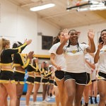 The Brenau University Volley Ball Team runs down the aisle as they are announced during Thursday's pep rally.