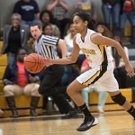 Brenau's Kalin Williams drives down the court.