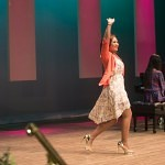 Danesha Troy waves to the crowd as she crosses the stage in historic Pearce Auditorium during the Brenau Ideal Scholarship Competition.