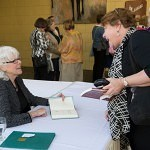 """Visiting lecturer and Professor at Piedmont College Barbara Brown Taylor, left, signs books for Patti Axel, as Tricia Colson Baxter, right waits during the EWM Lecture Series """"Religion for the 21st Century""""  held at the Brenau Downtown Center on Friday, April 11, 2014, in Gainesville."""