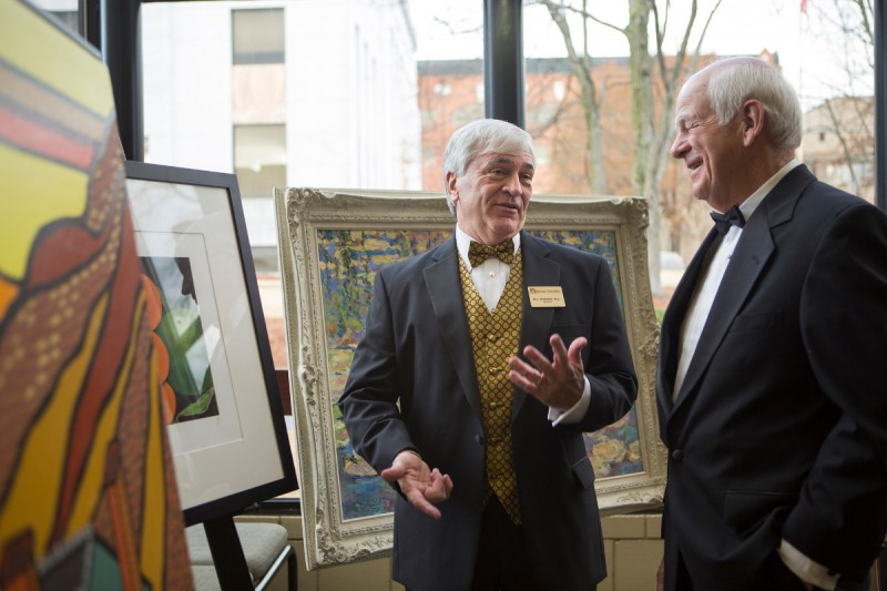 Brenau University President Ed Schrader, center, speaks with Brenau Trustees Chairman Pete Miller during the Brenau Gala which was the official opening of The Manhattan Gallery at the university's Downtown Center where the school's new doctorate in physical therapy will be housed.