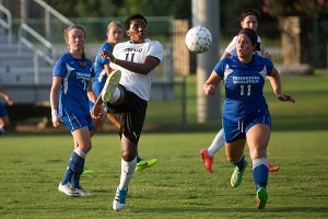 Brenau's Mary Achebo, left drives the ball around Tennessee Wesleyan's Kelsey Hall during the Golden Tigers' match against the Bulldogs.