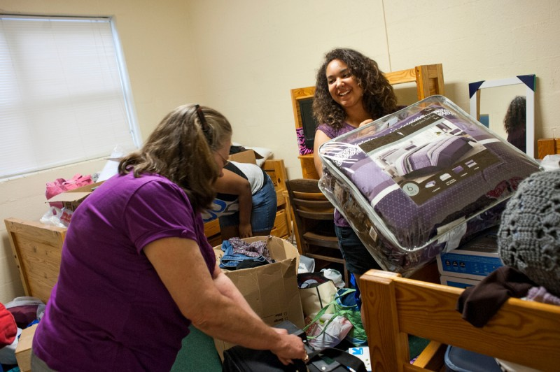 Karis Williams, right, smiles to her grand mother as she moves in with her roommate Shakeria Jackson during move in day at Brenau University's Gainesville campus.